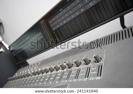 console mixer in music studio selective focus - stock photo