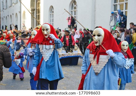 CONSTANCE, GERMANY - FEBRUARY 10 2013: Maskers and mummers walk in procession at the winter carnival Fastnacht in CONSTANCE, GERMANY - FEBRUARY  10 2013.