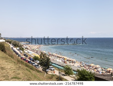 CONSTANTA, ROMANIA - AUGUST 22, 2014: Sunny day in South Eforie on shore of Black Sea - stock photo