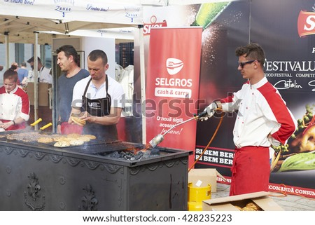 CONSTANTA, ROMANIA, 21.05.2016: Day of the city of Constanta in Romania. Festival mussels and scallops 2016.Chefs cook burgers and mussels on the streets of the city of Constanta in Romania