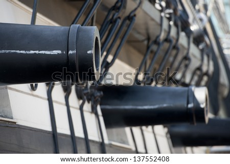 Constellation Frigate Cannons in Baltimore Harbor - stock photo
