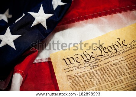 Constitution: USA Constitution Document with American Flag Behind