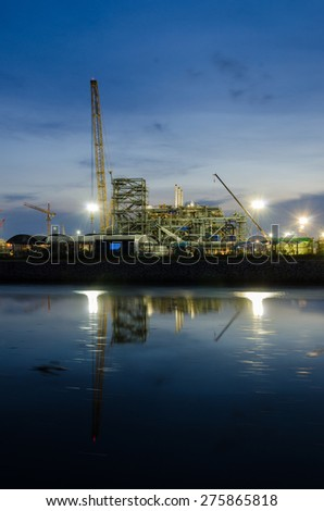 Construct Refinery tower at night - stock photo