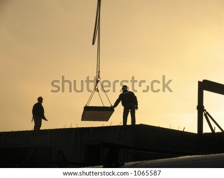 Constructing apartments at overtime. - stock photo