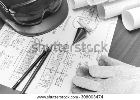 Construction and Architectural drawings black and white tone. with equipment on the table - stock photo