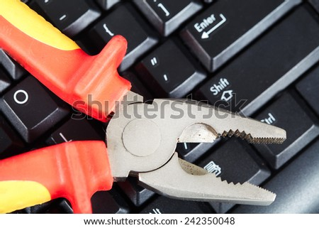 Construction and computer technology. Tools and keyboard - stock photo
