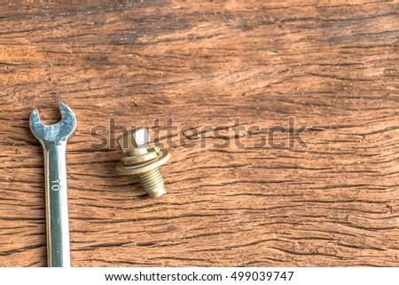 Construction  and tools on wooden surface with copy space at the center. Set of tools.