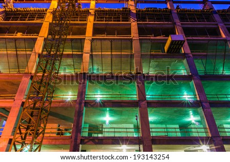 Construction at night with lights against the blue sky - stock photo