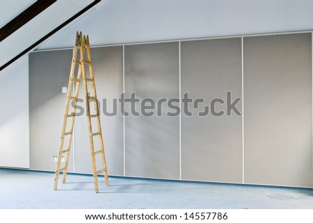 construction background with ladder indoor - stock photo