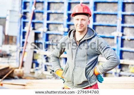 construction builder worker at building site  - stock photo