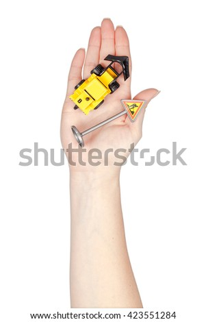 construction car and road signs in a hand isolated on white background. driving school concept - stock photo