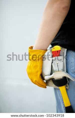construction concept,builder with yellow  working gloves on building site - stock photo