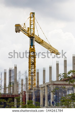 Construction crane and building in construction site
