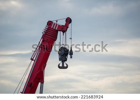Construction crane for heavy lifting - stock photo
