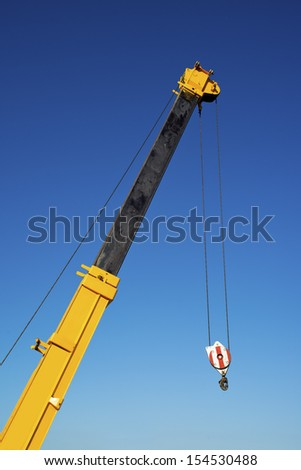 Construction crane hook, industrial machinery detail.