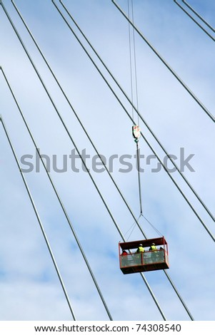 Construction crane lifting workers to the top of new bridge, Belgrade, Serbia
