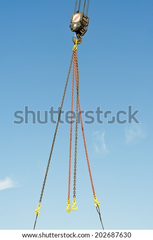 Construction crane. Load gripping chains. - stock photo