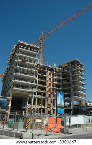 construction crane on a building site - stock photo