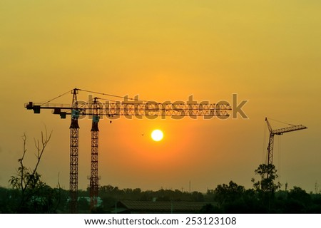 Construction cranes and industrial Create silhouettes Locally with sun light shots. - stock photo