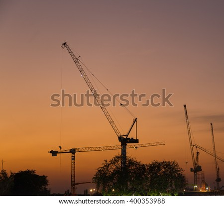 Construction cranes in evening Construction cranes are building in the evening.
