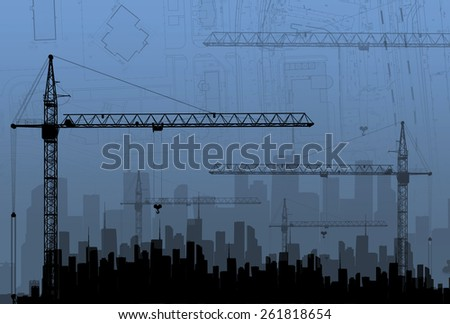 Construction cranes on the background buildings. The concept of building. - stock photo