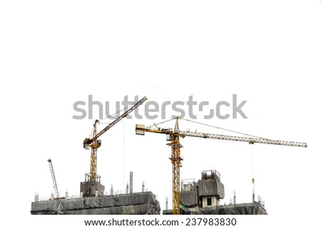 construction cranes on white background with copy space - stock photo