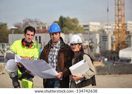 Construction crew working on site - stock photo