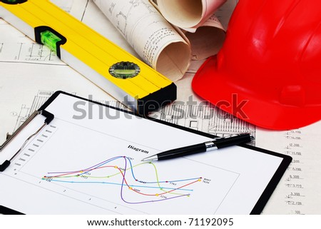 construction drafts and tools on the table - stock photo