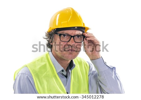 Construction engineer . Close-up of an European young man wearing a hardhat smiling and looking at camera, arms crossed standing isolated on white background.