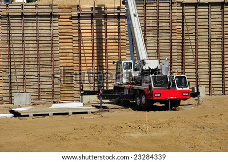 Construction equipment and concrete forms on a large California freeway project - stock photo