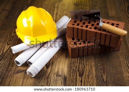 Construction equipment on blueprints  - stock photo