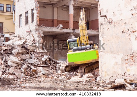 construction equipment parses an old building - stock photo