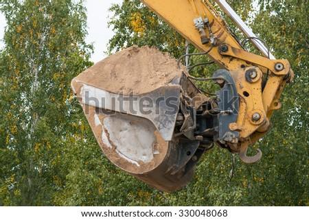 Construction excavator - stock photo