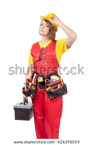 construction female worker in yellow helmet, toolbelt and red workwear with toolbox isolated on white background - stock photo