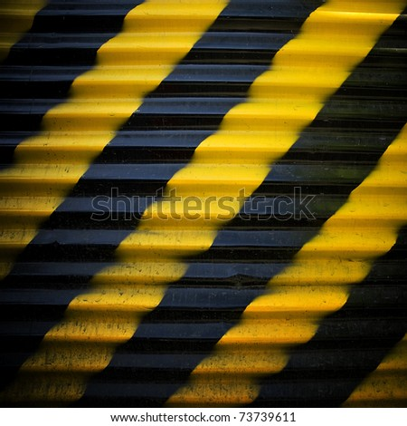 construction fence with warning stripe - stock photo