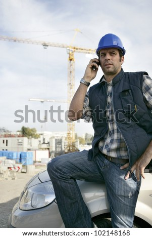 Construction foreman arriving in to work - stock photo
