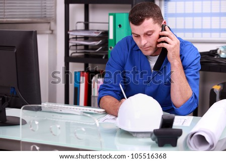 Construction foreman speaking on the phone