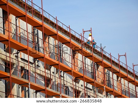 Construction frame next to a new building - stock photo