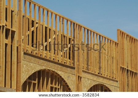 Construction framing detail of new building. - stock photo