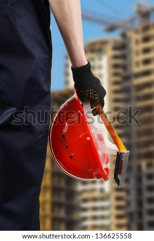 Construction hard hat in hand