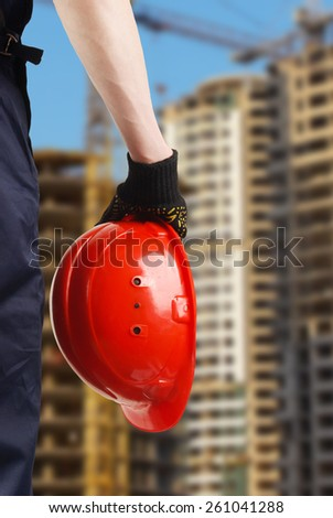 construction hard hat in hand - stock photo