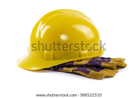 construction hard hat with gloves isolated on white  - stock photo