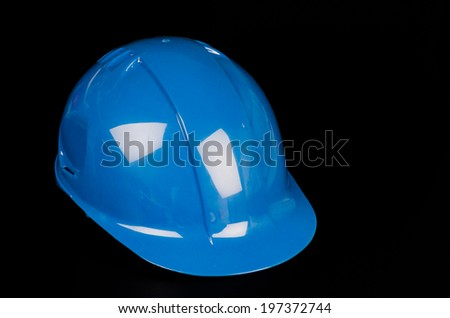 Construction hat on black background