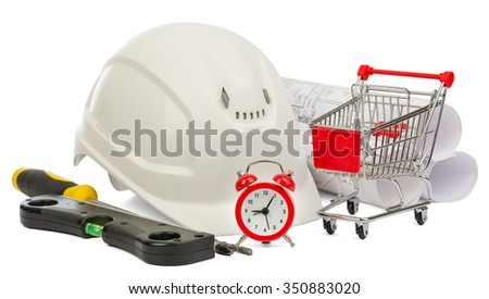 Construction helmet, alarm clock and shopping cart on isolated white background - stock photo