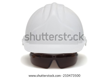 Construction helmet and safety goggles on white background - stock photo