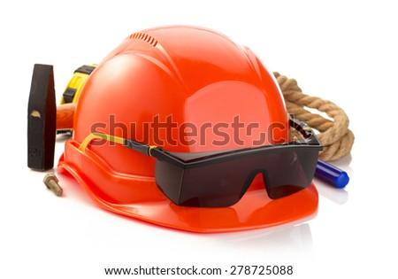 construction helmet and tools isolated on white background - stock photo