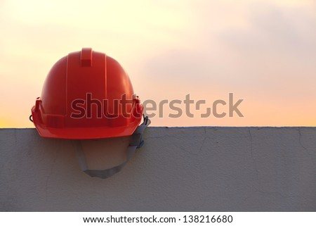 Construction helmet at sunset - stock photo