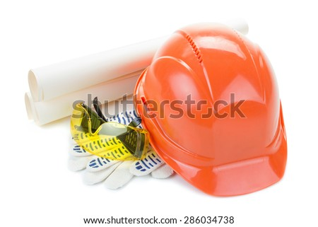 Construction helmet with gloves, goggles, plan on a white background - stock photo