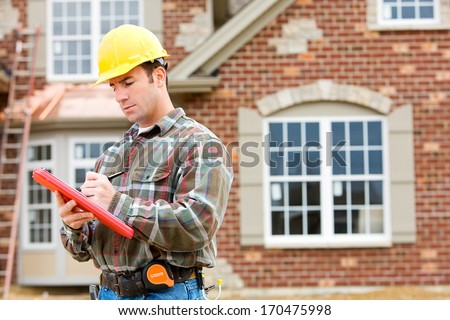 Construction: Home Inspector Reviews Documents. - stock photo
