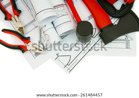 Construction house. Repair work. Drawings for building and working tools on white a background.